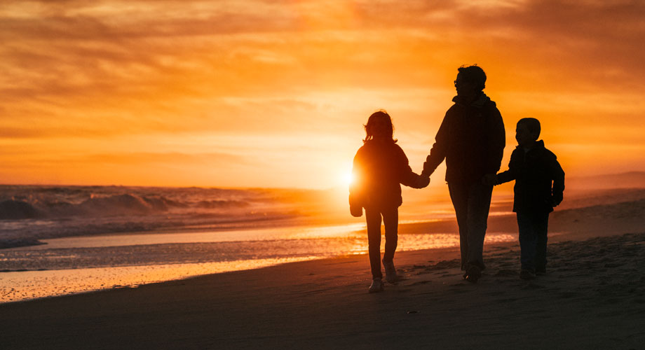 Silhouette of Family on Beach at Sunset